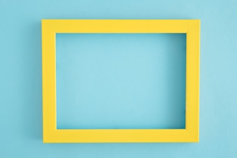 An empty yellow border frame on blue background