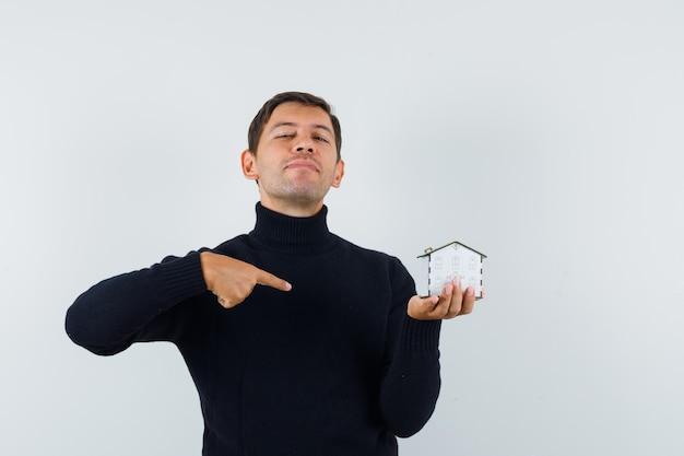 표현적인 남자가 스튜디오에서 포즈를 취하는