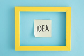 An idea sticky note with yellow border over the blue background