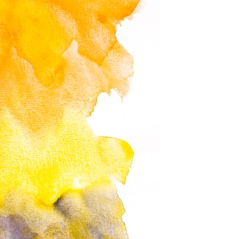 An orange and yellow watercolor stain background