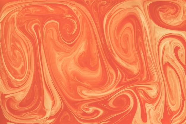 オレンジ色の大理石の混合テクスチャパターン背景