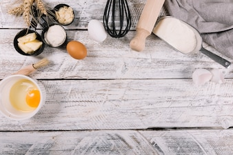 An overhead view of baked ingredients on white wooden table