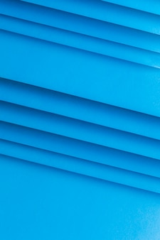 An overhead view of blank paper striped background