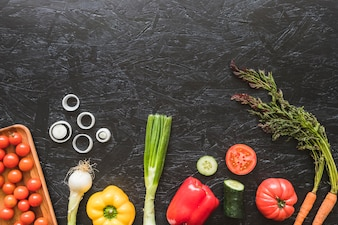 An overhead view of fresh vegetables on kitchen counter