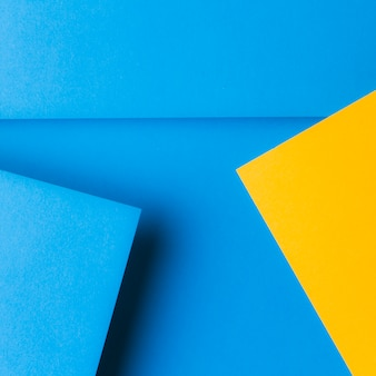 An overhead view of pop up paper on blue background