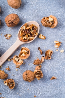 An overhead view of walnuts kernel on wooden spoon