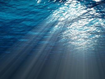 An underwater scene with sunrays shining through the water