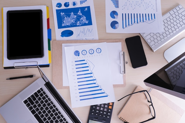 Analyzing the work accounting on laptop  investment concept.