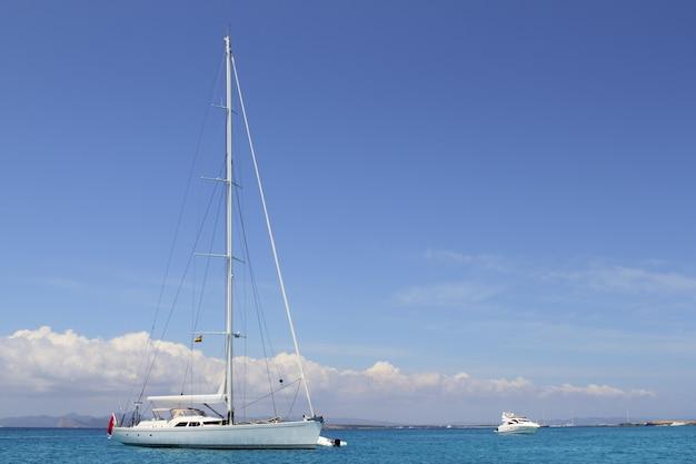 Anchored sailboat formentera turquoise illetes