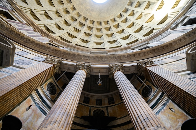 Ancient architectural masterpiece of pantheon in roma, italy. panorama of inside interior. dome. rome, italy