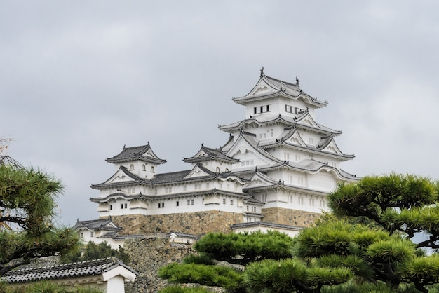 Ancient architecture of himeji castle with japanese garden in hyogo prefecture, japan