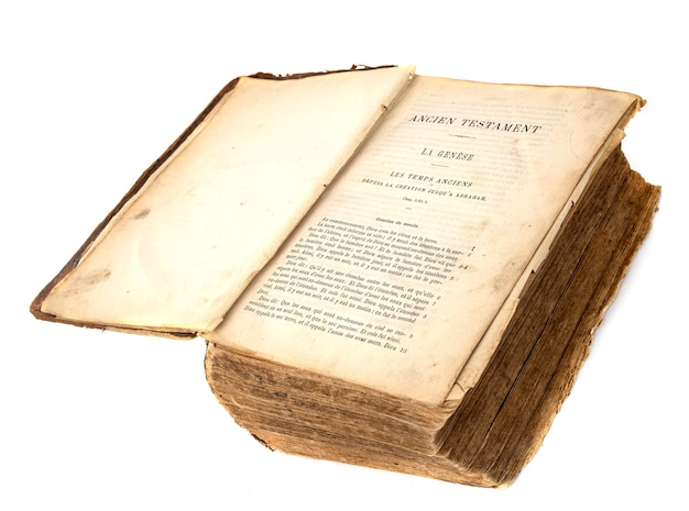 Ancient bible in front of white background