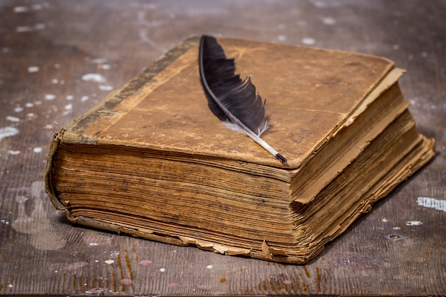 Ancient book in a grunge style on a wooden table