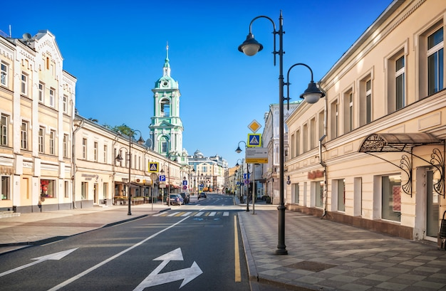 Ancient buildings and bell tower of the church of john the baptist on pyatnitskaya street in moscow on an early sunny summer morning