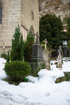 Ancient cemetery at cold winter day