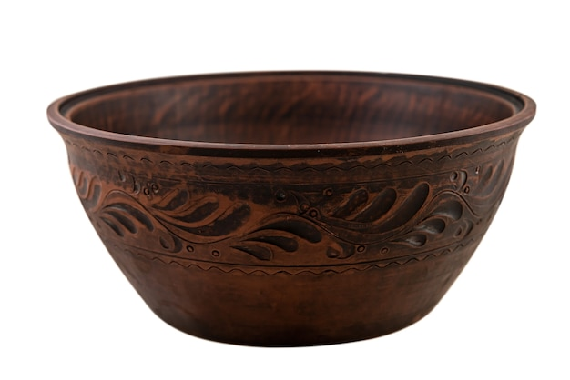 Древняя керамическая плита коричневой глины изолированная на белизне. ручной работы