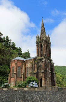 Ancient chapel on the shore of green lake at the island of sao miguel
