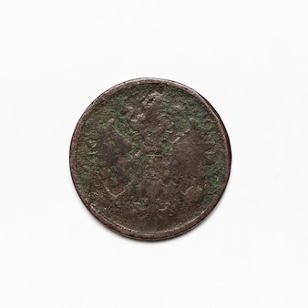 Ancient coin of russian empire 1865. close-up isolated on white surface.