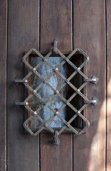 Ancient door with grate