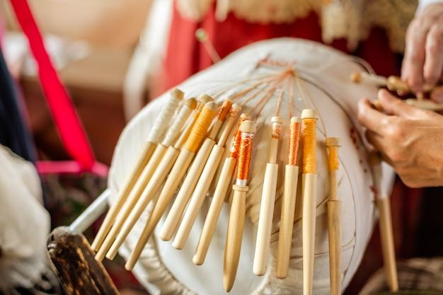 Ancient folk art of lace-making bobbin.
