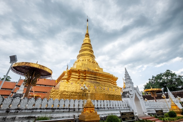 Ancient golden pagoda traditional northern at wat phra that chae haeng