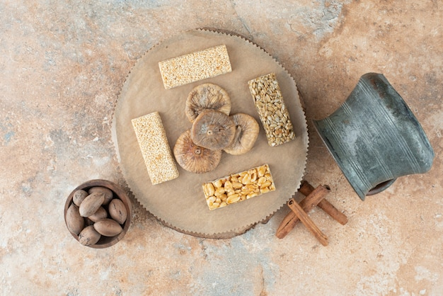 Ancient kettle and peanut brittles on marble background