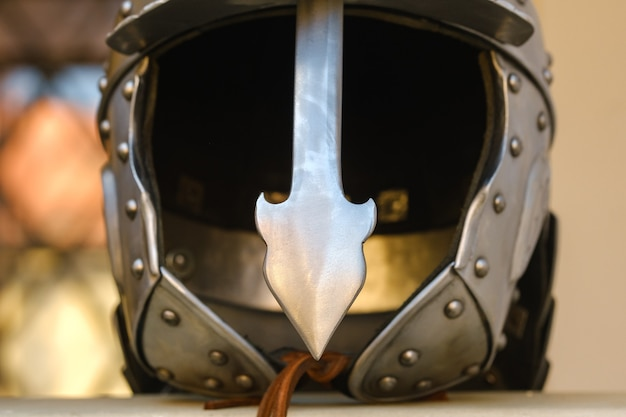 An ancient knight's helmet with armor.a medieval concept. Premium Photo