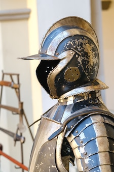 An ancient knight's helmet with armor.a medieval concept.