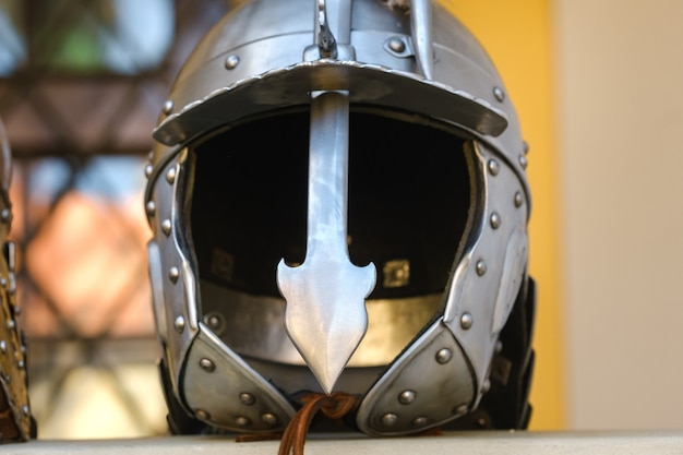 An ancient knight's helmet with armor.a medieval concept Premium Photo