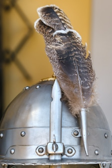 An ancient knight's helmet with a feather .medieval concept