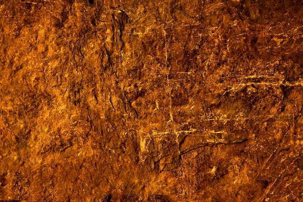 Ancient lava granite stone surface of cave for interior wallpaper and background