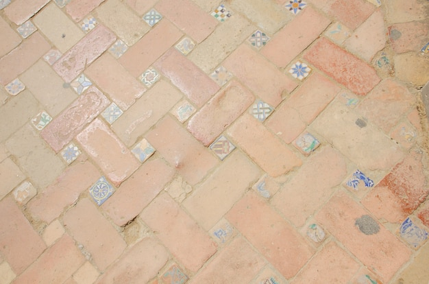 Ancient mosaic pattern at streetof old town of seville, spain