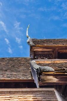 Ancient northern thai temple wooden roof.