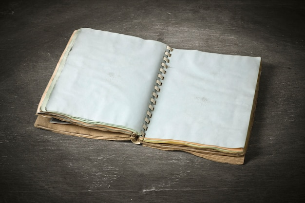 Ancient notebook open on the wood texture background