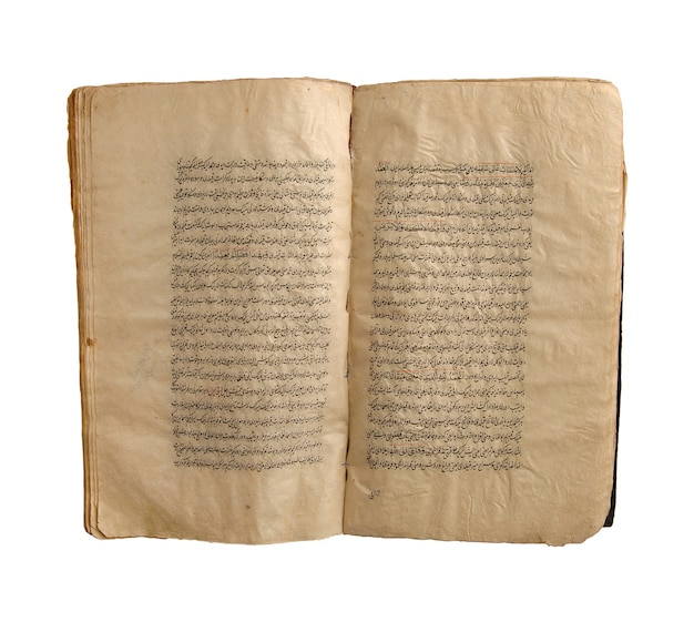 Ancient open arabic book on a white background. old arabic manuscripts and texts
