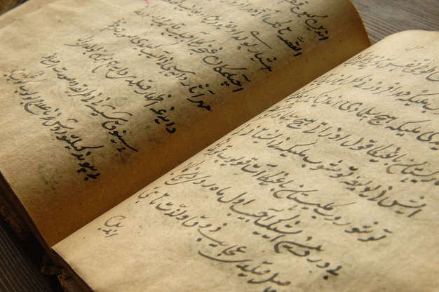 Ancient open book in arabic. old arabic manuscripts and texts