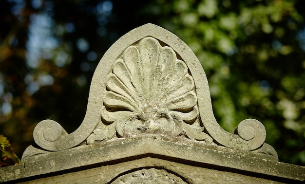 An ancient ornament on the tomb of the 18th century