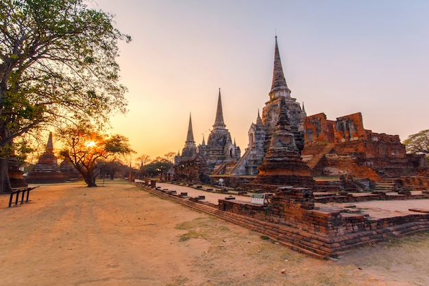 Ancient pagoda at wat phra sri sanphet temple under sunset time