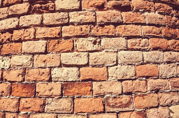 古代のパターンのレンガの壁のテクスチャ
