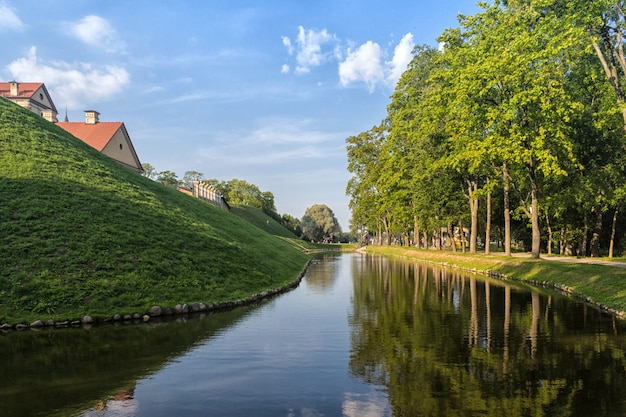 Ancient restored castle with a moat in the nesvizh  city.