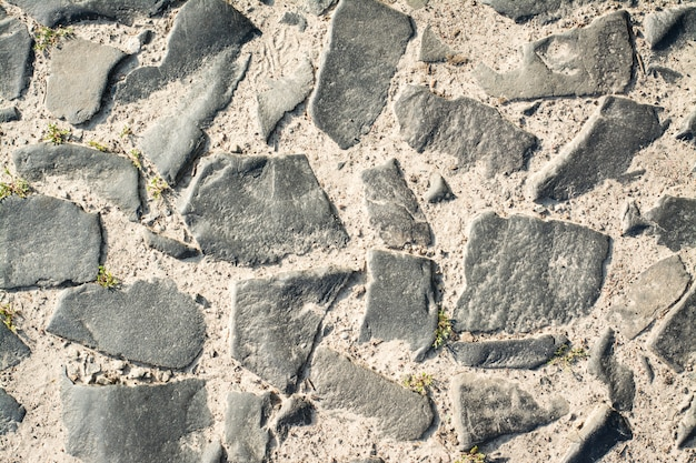 Ancient road made of cobblestone background texture