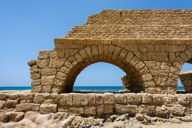Ancient roman aqueduct in ceasarea at the coast of the mediterranean sea