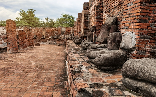 Ancient statue of buddha and archaeological site at ayutthaya historical park, ayutthaya province, thailand. unesco world heritage
