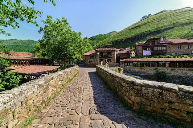 Ancient stone bridge crossing a river in medieval village