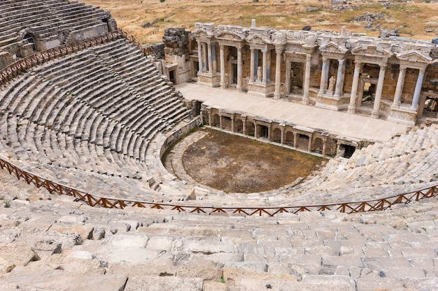 The ancient stone theatre and greek amphitheatre in hierapolis near pamukkale in turkey now a unesco world heritage site viewed looking down from the top of the seats