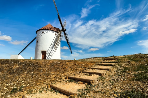Ancient stone windmills in la mancha. blue sky with clouds.