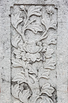 Ancient style grunge flower pattern on a pole