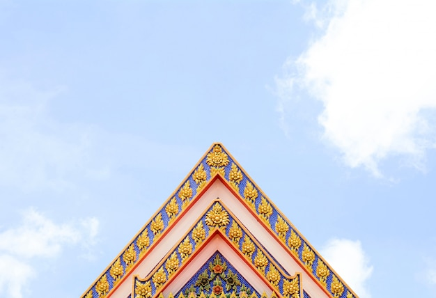 Ancient thai stucco pattern art on roof at temple - buddha temple in thailand