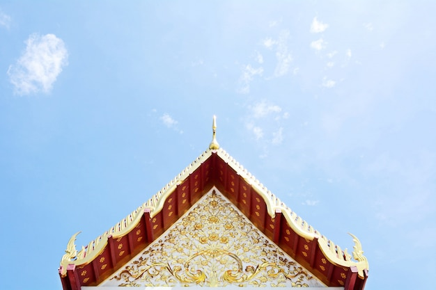 Ancient thai stucco pattern art on roof at temple