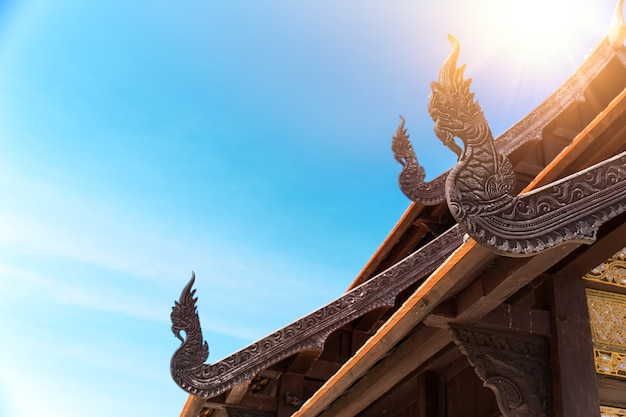 Ancient thai temple arts architecture naga wood carved at chapel roof